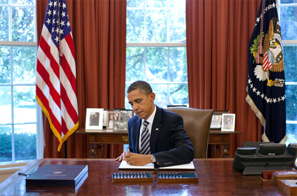 Done Deal: President Barack Obama Signs The Budget Control Act of 2011 In The Oval Office